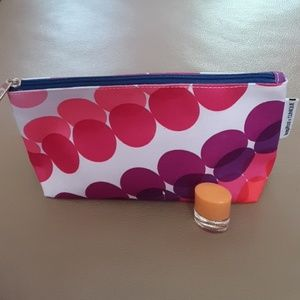 Happy and cosmetic bag by Clinique.